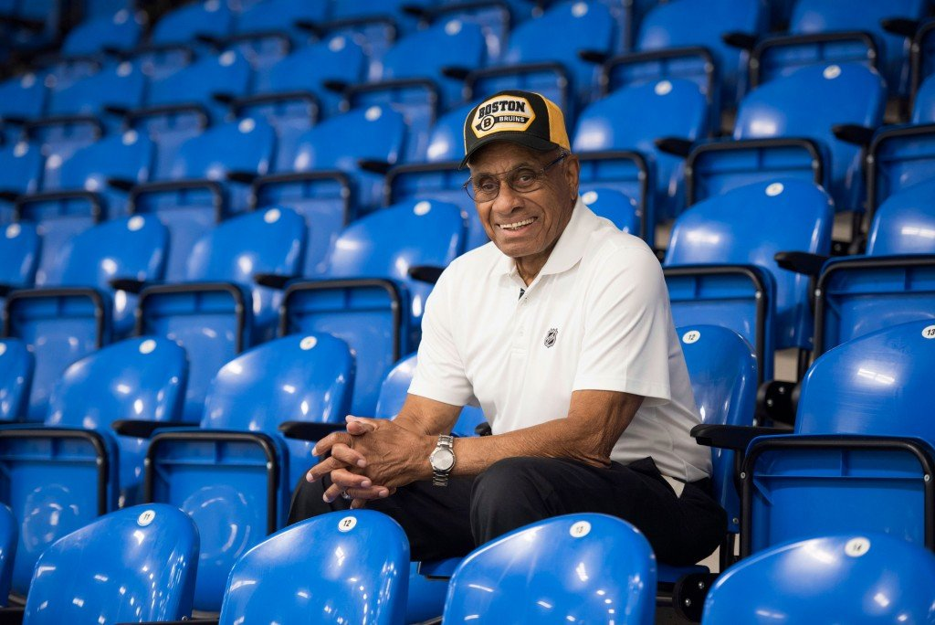 In this June 22, 2017, photo, Willie O'Ree, known best for being the first black player in the National Hockey League, poses for a photo in the Willie O'Ree Place in Fredericton, New Brunswick, Canada. Mandatory Credit: Stephen MacGillivray/The Canadian Press/AP