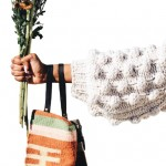 Person holding a bag and flowers