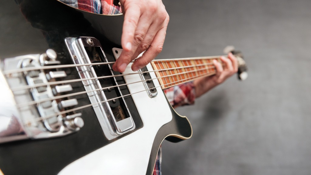 Closeup Of Man Hands Holding And Playing Guitar