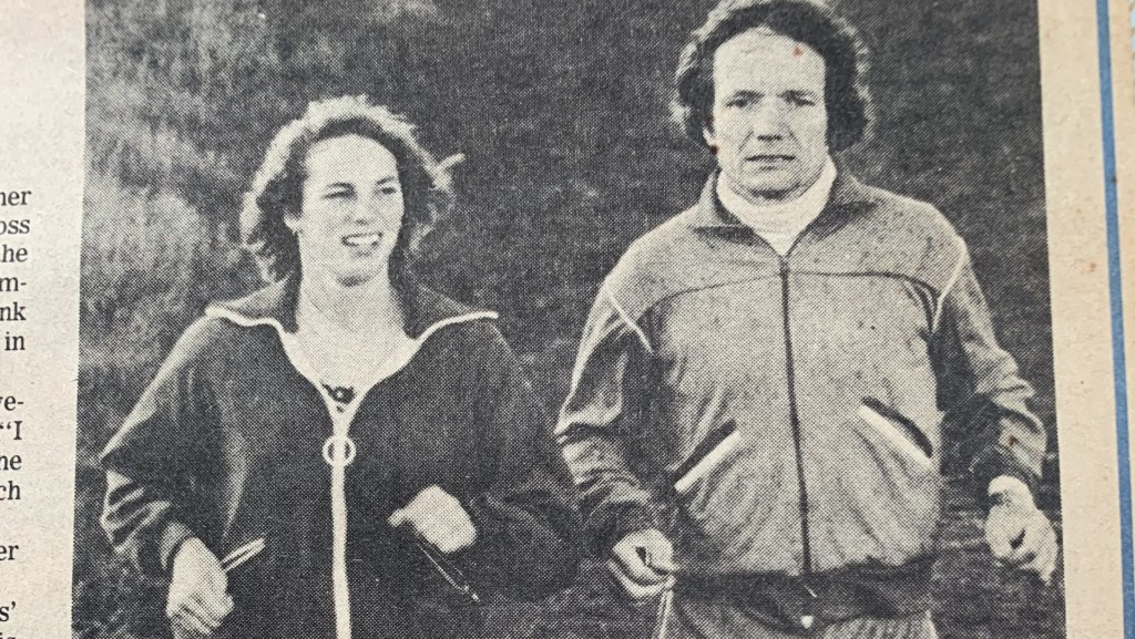 1978 Wisconsin State Journal clipping black and white photo of two runners side by side, student Sarah Docter on left and coach Mark Parish on right.