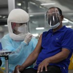Death Rates Soar In Southeast Asia As Virus Wave Spreads