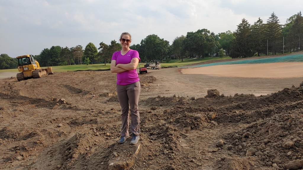 Golf course architect and teacher Sara Mess stands in the dirt at Glenway where she is helping remodel the course.