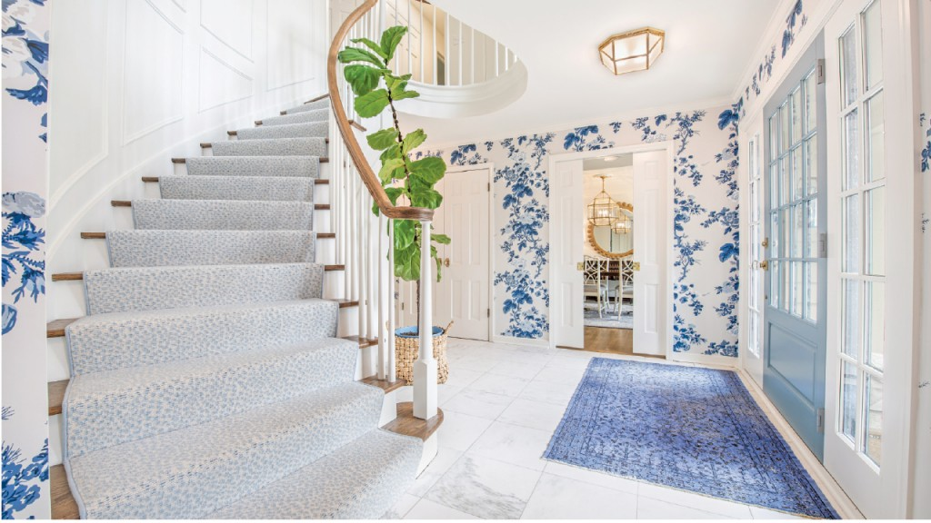 Carpeted Staircase and marble floored entryway