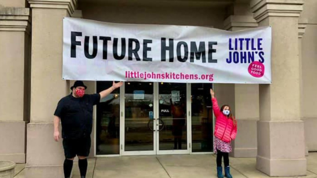 Dave Heide and Morgan Marsh-McGlone in front of a sign that says Future Home of Little John's