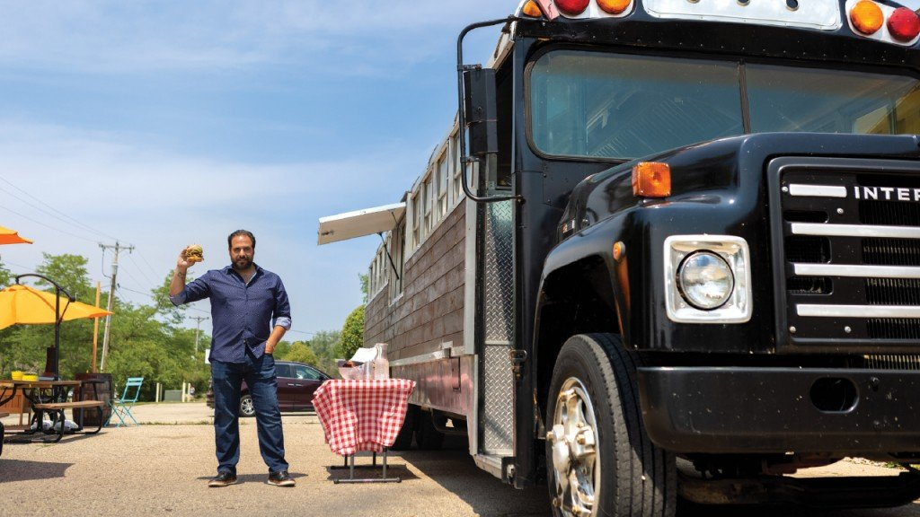 David Rodriguez next to his food truck, The International