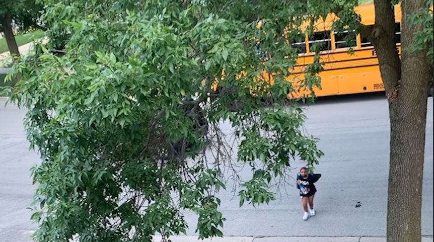 Kid almost gets hit getting off bus