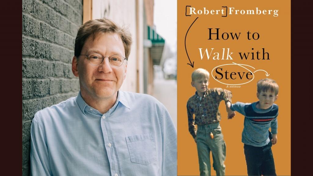 Author Robert Fromberg stands in a button up shirt and glasses against a brick wall. To his right is the cover of his book, 'How to Walk with Steve' which shows young Robert and young Steve holding hands in a manner which suggests Steve, who has autism, is trying to get away.