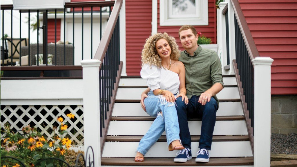 Chloe and Ryan Homan on the steps of their home