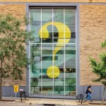 Question mark art through the window of Central Library