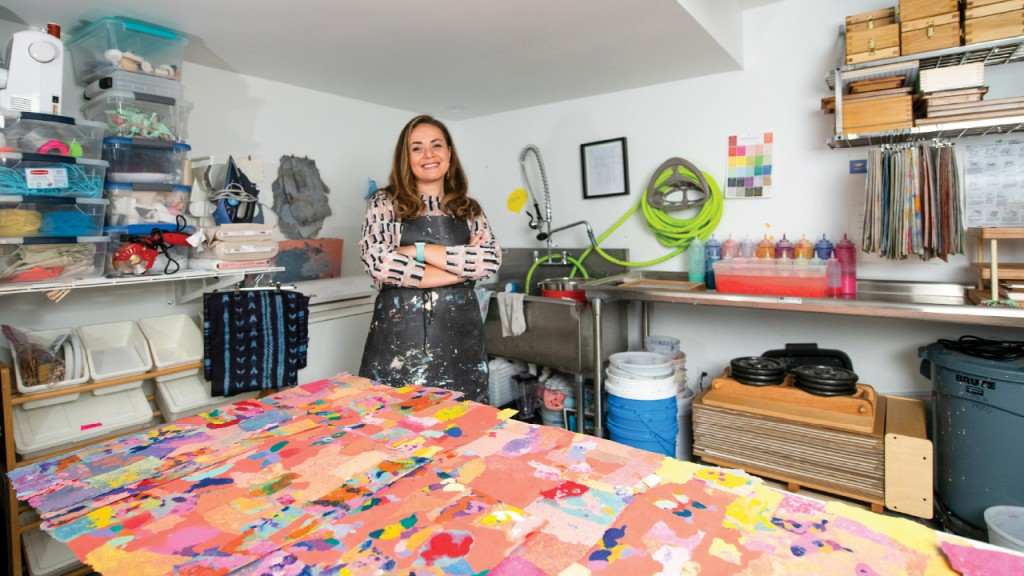 Maria Amalia in her studio standing in front of pieces of paper