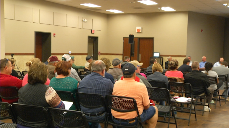 Residents Voice Sludge Dumping Concerns at Public Meeting
