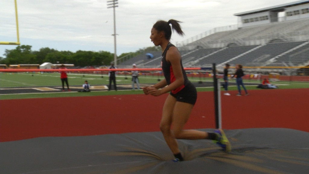 East Girl Has Big District Track Meet