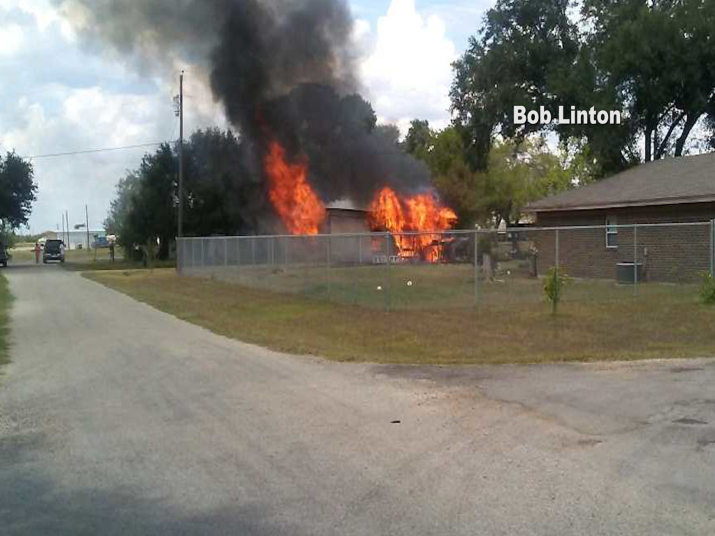 Homeowner loses riding lawn mower and car after garage goes up in flames