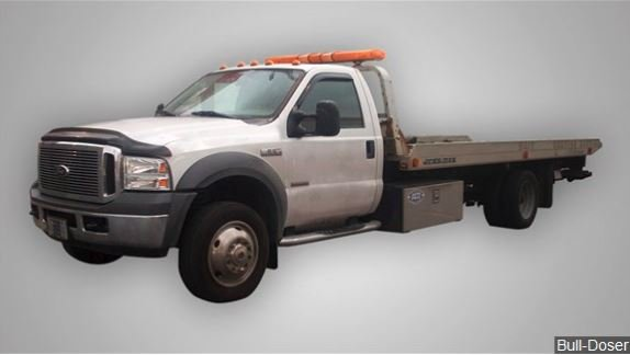 Tow truck driver charged in death of man during SUV repo