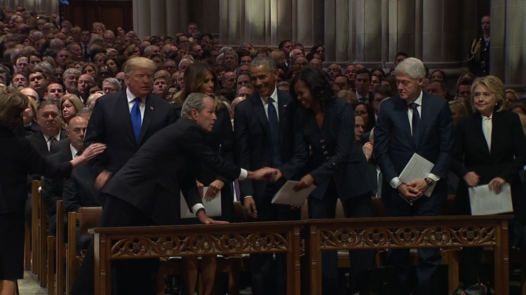 Michelle Obama, George W. Bush share warm moment