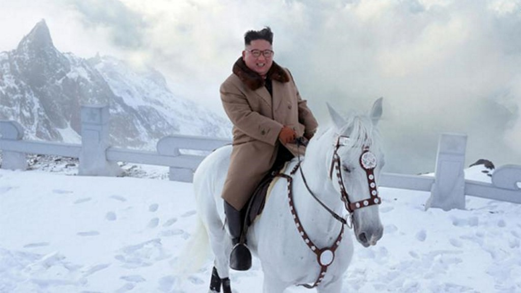 North Korean leader Kim Jong Un rides white horse on symbolic mountain