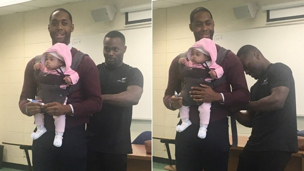 Professor holds baby during class after dad can't find babysitter