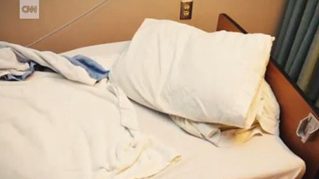 Photo shows woman slumped over pillow in nursing home