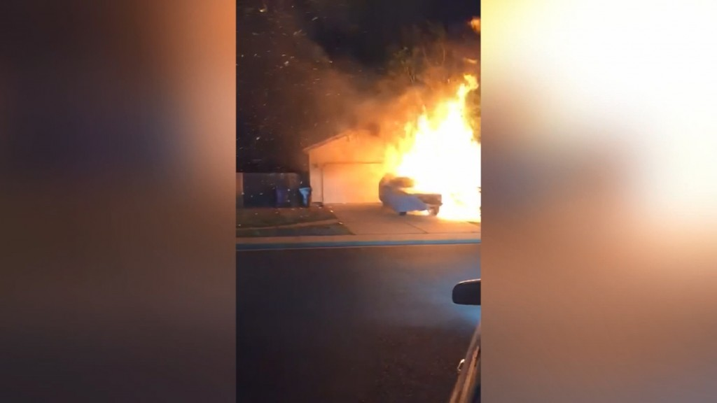 Men rush into house to save woman during fireworks fire
