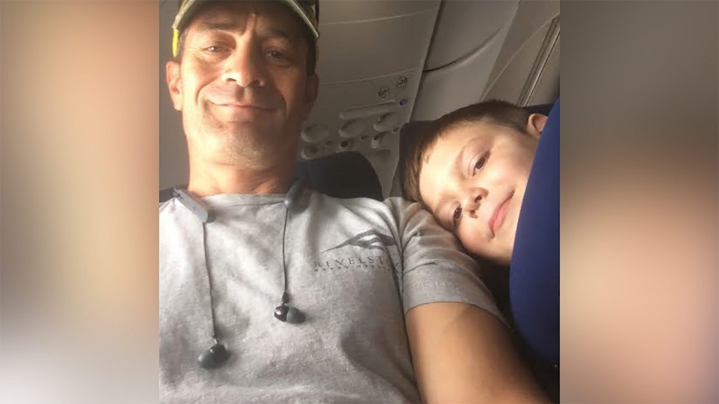 Boy with autism bonds with seatmate on plane