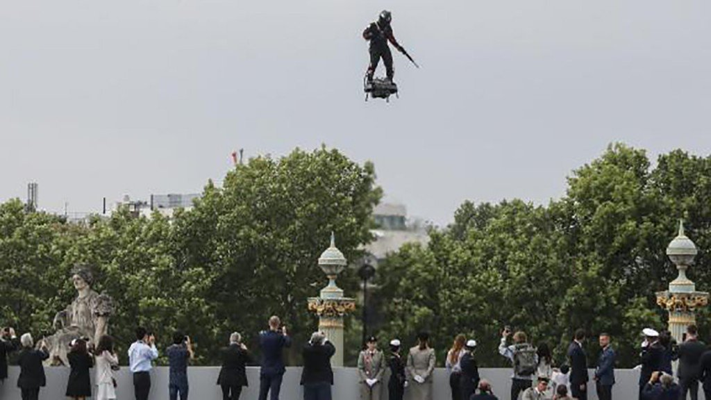Man on flying board soars above Bastille Day crowds in Paris