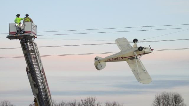 Pilot rescued after plane crashes, gets tangled in power lines