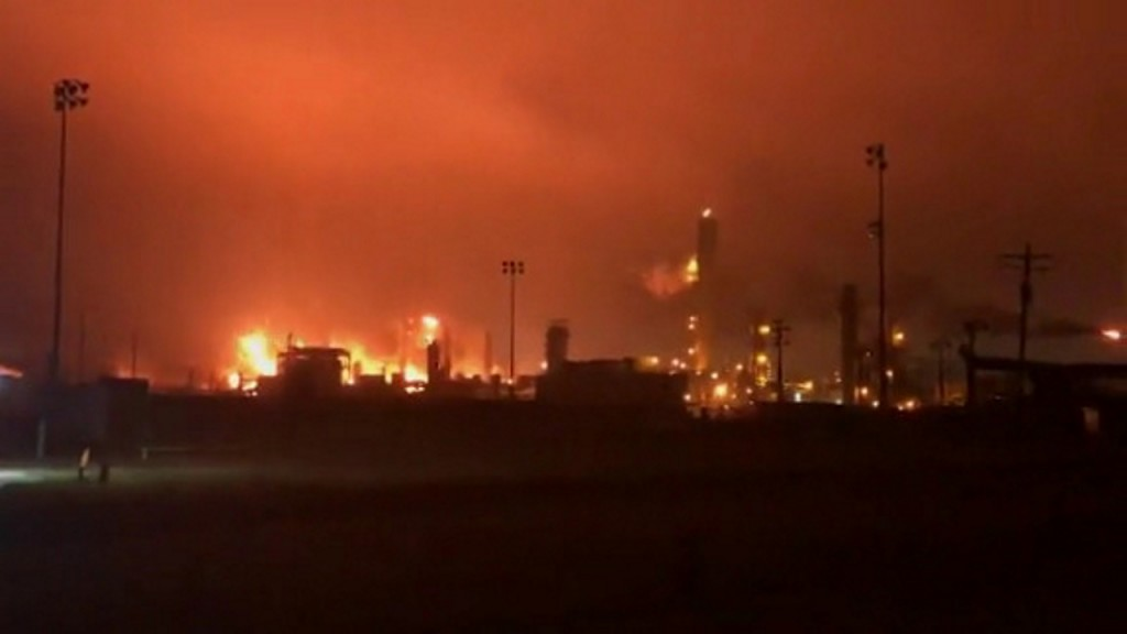 Day after explosions, Texas chemical plant fire continues to burn