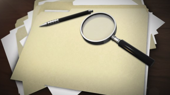 Documents in folders with pen and magnifying glass