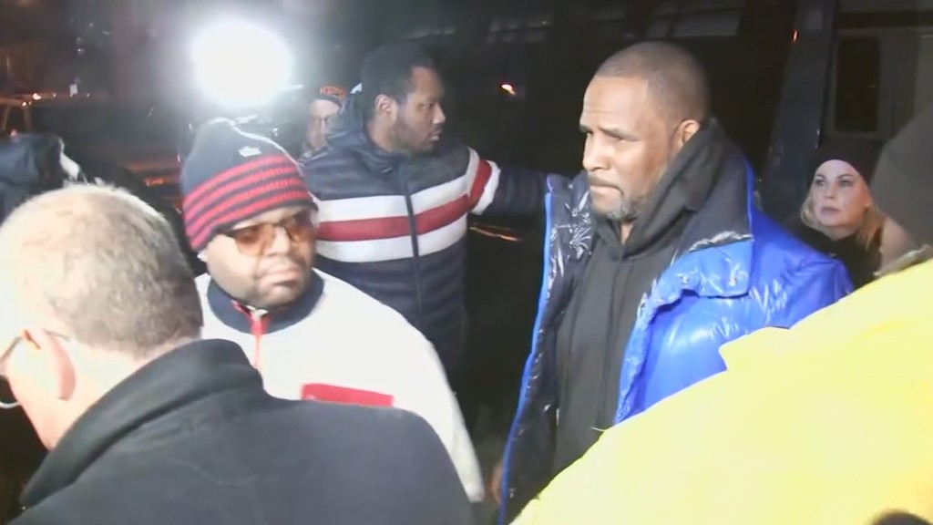 R. Kelly turns himself in to Chicago police after being indicted on sexual abuse charges