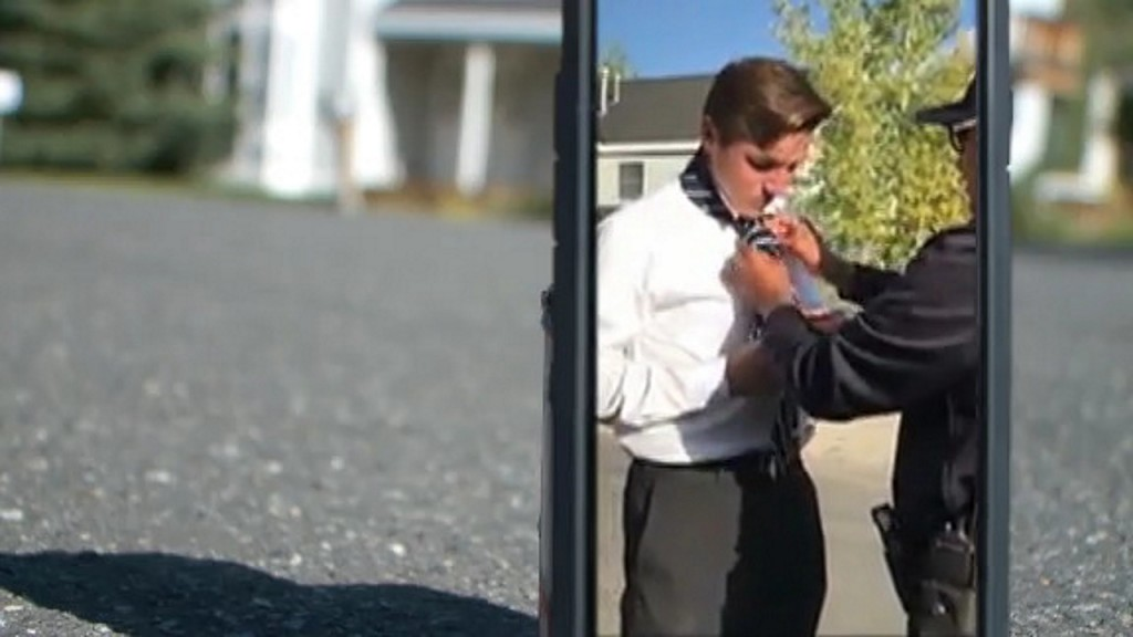 Officer teaches teen how to tie necktie