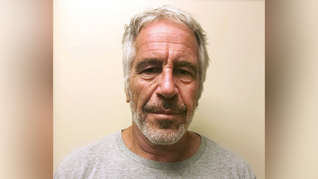 Warden at prison where Epstein died temporarily reassigned