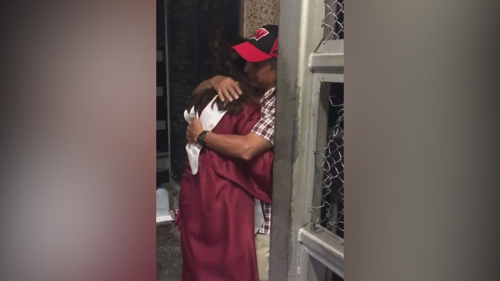Deported dad couldn't see daughter graduate, so she met him at border