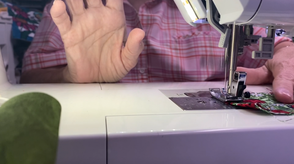hands sewing at sewing machine