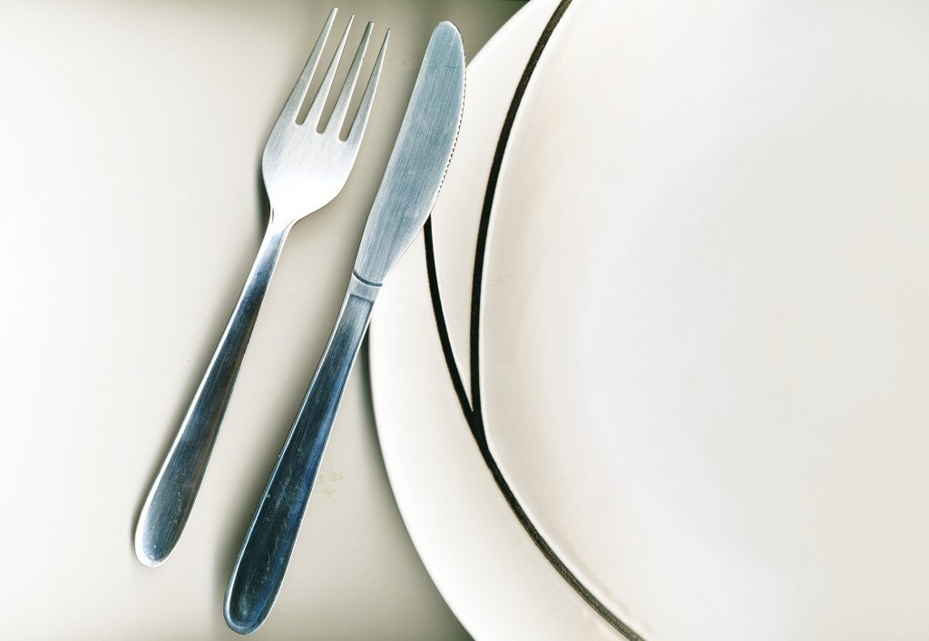 Knife And Fork With Modern Dinner Plate On White