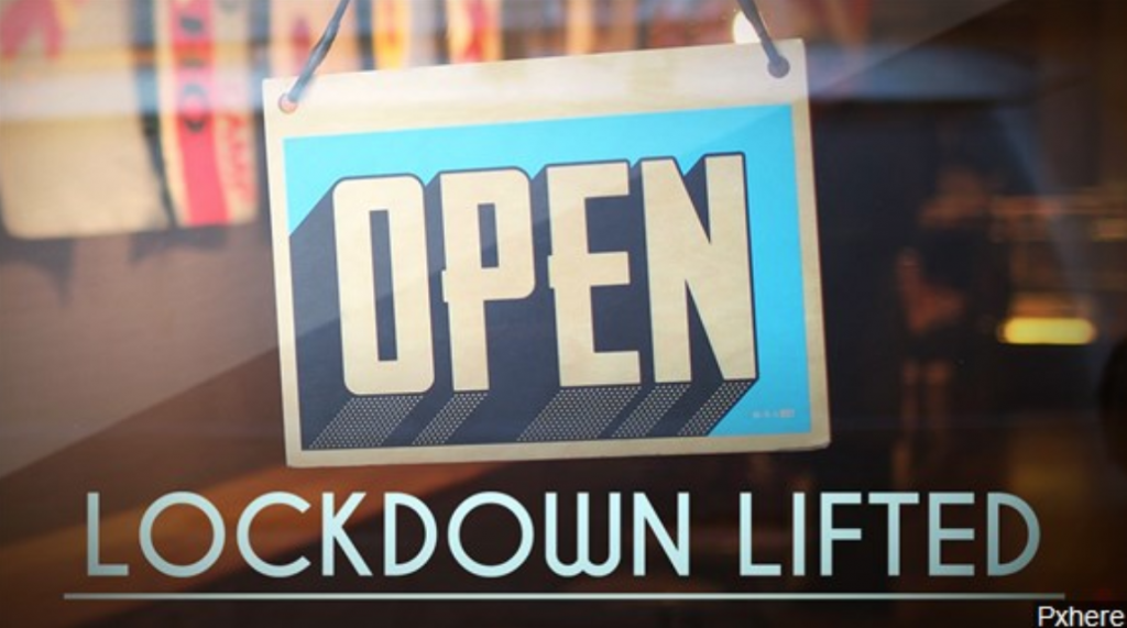 "Open for business sign with ""Lockdown lifted"" written beneath it"