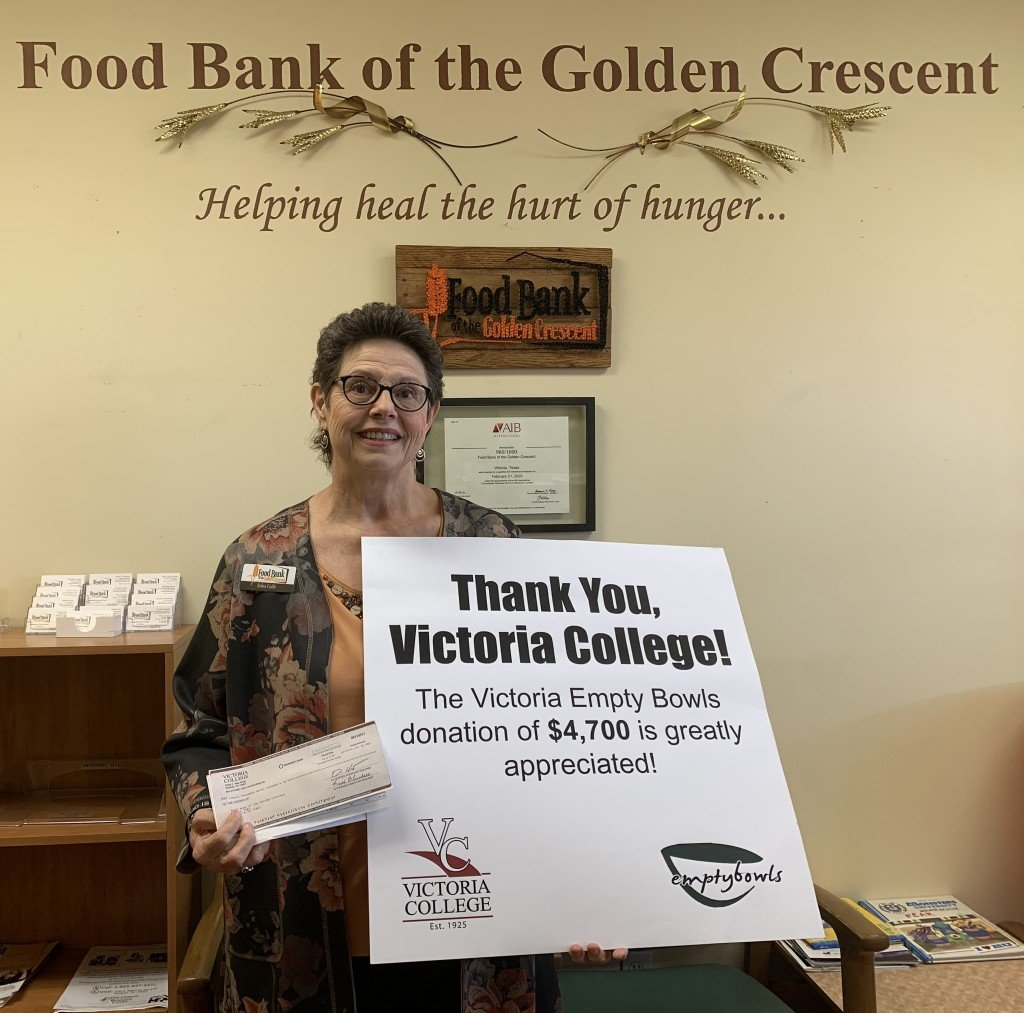 Food Pictured holding the $4,700 check is Food Bank of the Golden Crescent President and CEO Robin CadleBank Donation
