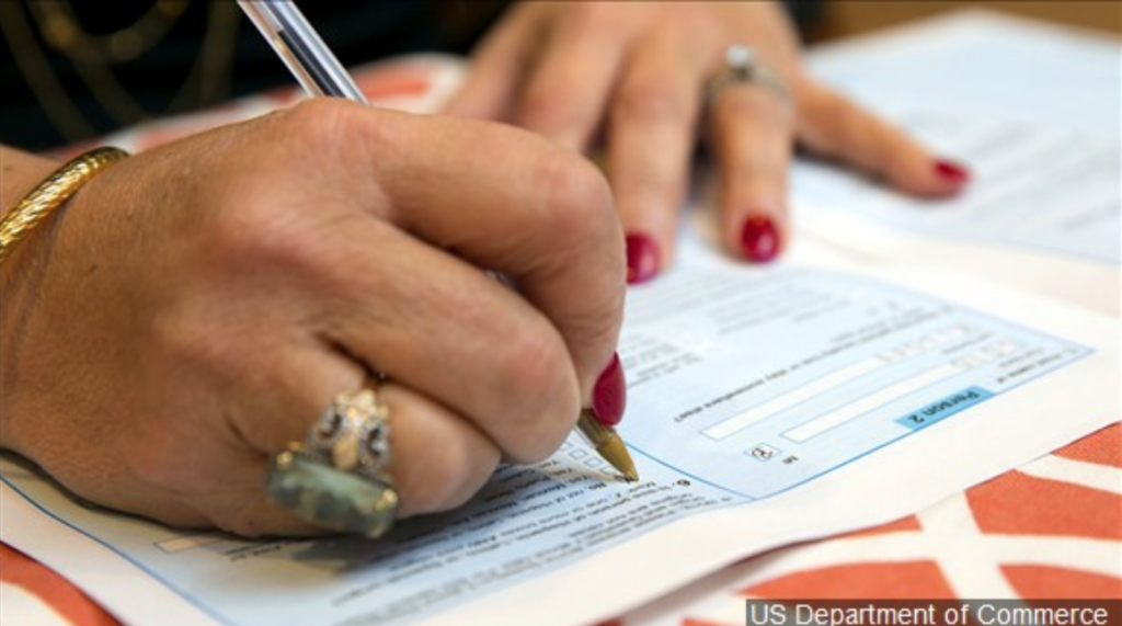 Woman filling out the Census by hand