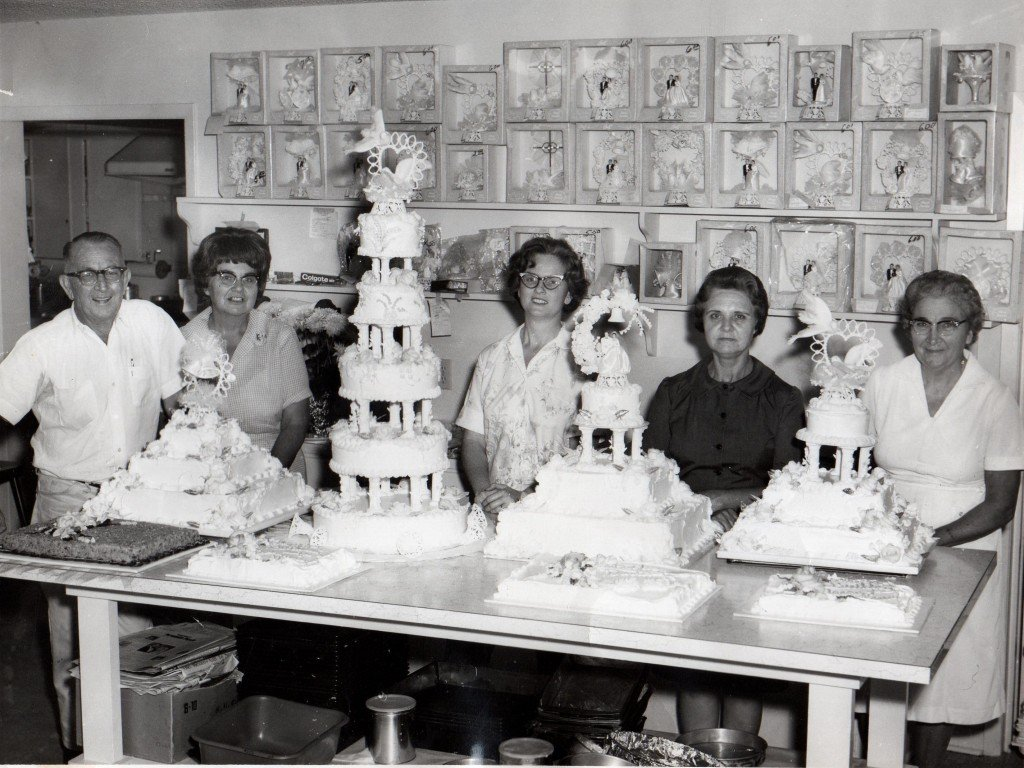 Tom Halepaska's mom and dad posing for a photo with other employees when Halepaska's Bakery first opened.