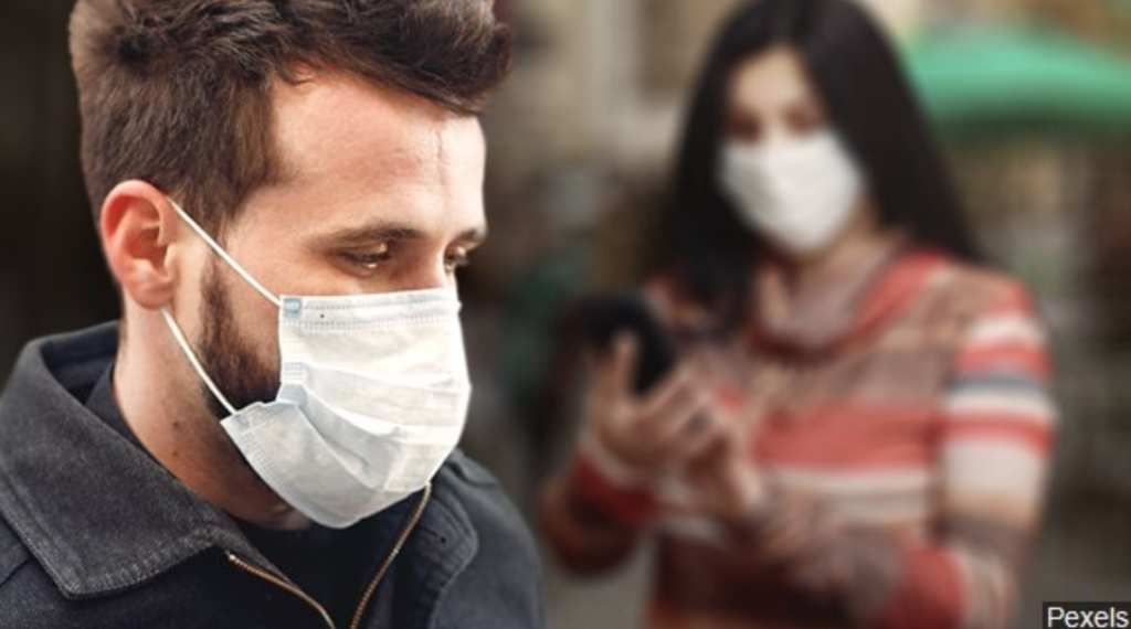 A man and woman wearing face masks during the COVID-19 pandemic