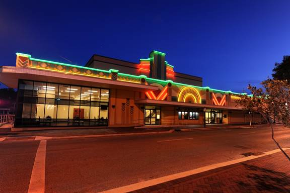 Front elevation of the Leo J Welder Cener at night