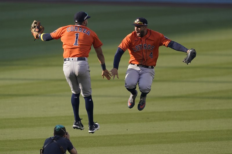 Correa and Springer rally Astros past the A's