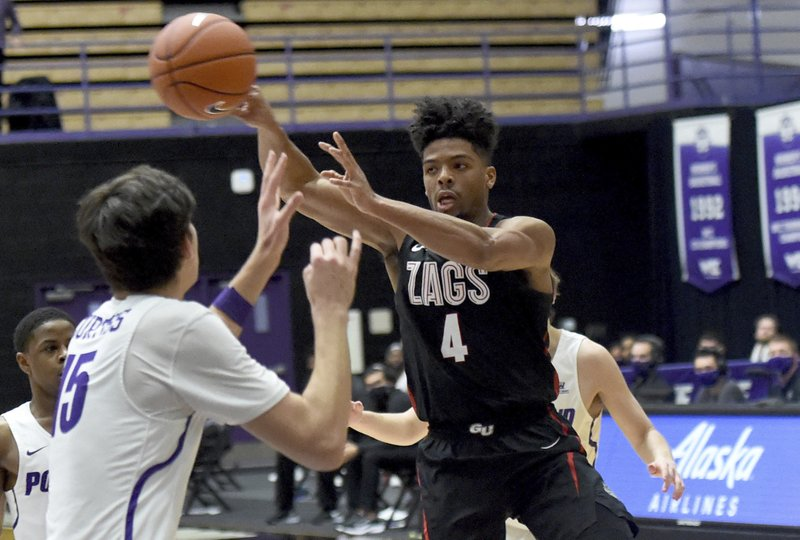 The Zags received 63 of 64 first-place votes from a national media panel in the poll released Monday and the Bears had the other one.