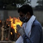 The Latest: India Reports Record For Single Day Virus Deaths