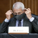 The Latest: Fauci: Reasonable For Businesses To Keep Masks