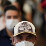 The Latest: States, Businesses Reconsider Mask Wearing In Us