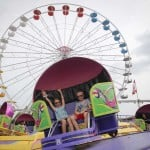 The Latest: Midwest State Fairs: Few Masks, Free Vaccines