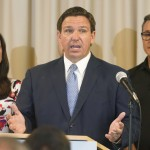 The Latest: Florida School Mask Ban Faces Legal Challenge