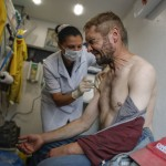 The Latest: Russia Hits Another Daily Record Of Virus Deaths