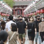 The Latest: Japan Races To Vaccinate As Coronavirus Surges