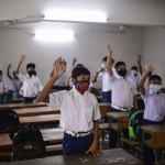 The Latest: Bangladesh Schools Open, Most Staff Vaccinated